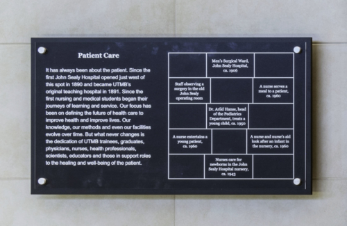 Close up photo of the 'Patient Care' description plaque that describes the importance of patient care through UTMB's history. This plaque also labels all of the historical photos in the accompanying history panel.